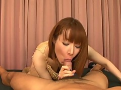 Cute asian girl sucks on a cock before giving it a nice footjob