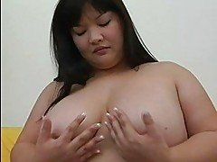 Big asian momma with large tits plays with her sex toy