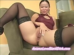 Asian chick shoves huge dildo deep into h ...