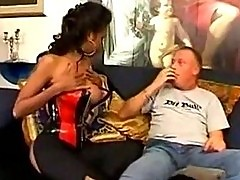 Hot thai girl in sexy dress giving blowjob on the couch