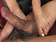Yui loves using her oil and her feet to make this guy cum hard