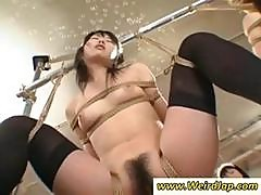 Two Asian Maids Are Hung Up And Tied Up For Some Pussy Vibration
