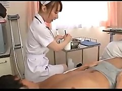 Nurse massaging guy giving handjob on the bed in the hospita