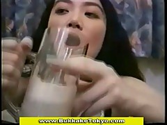 Thirsty japanese slut drinking glass of cum
