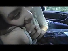 Asian hottie gives blowjob in a car